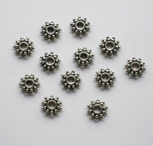 Metalen spacers 9 mm 12 stuks.